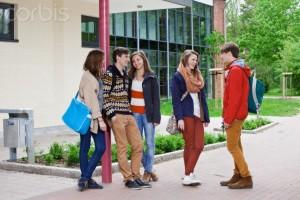06 May 2012 --- High school students flirting and having conversation at campus --- Image by © Sven Hagolani/Corbis
